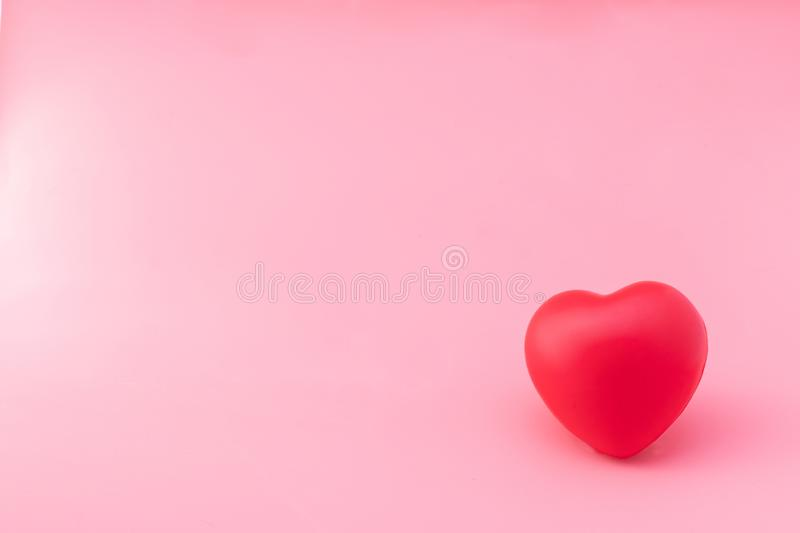 Red Heart On Pink Fabric Background Concept For Valentine