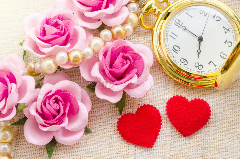 Red heart and pink rose with gold pocket watch. Red heart and pink rose with gold pocket watch on fabric background. Love of time concept stock photography