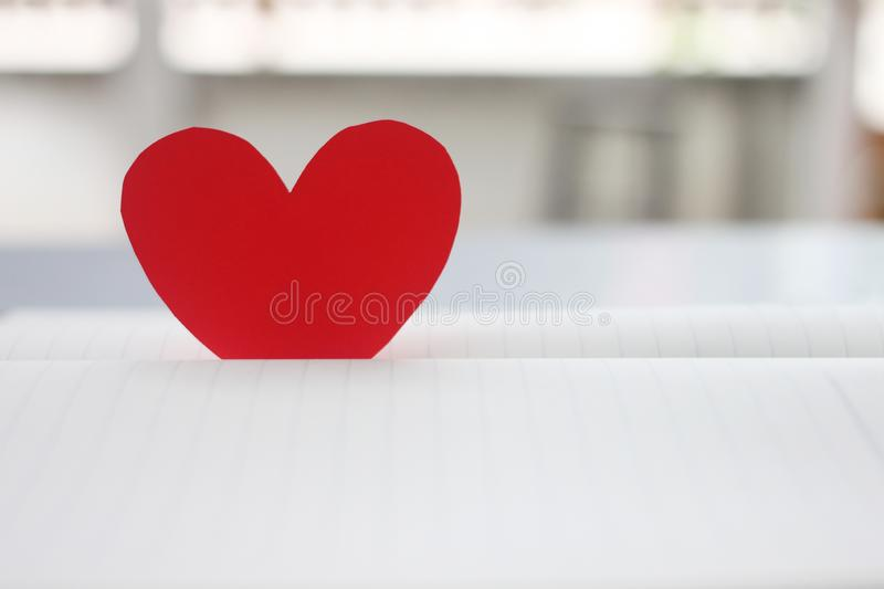 A red heart are placed on an empty book royalty free stock photo