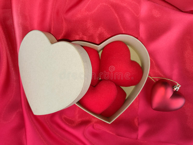 Red heart on red fabric for valentines day.  stock photography