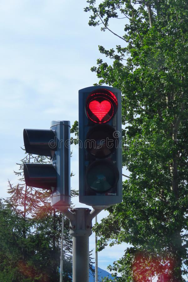 Red heart romantic traffic sign, Akureyri, Iceland. Red heart-shaped traffic light as a symbol of hope and love in Akureyri, Iceland stock image