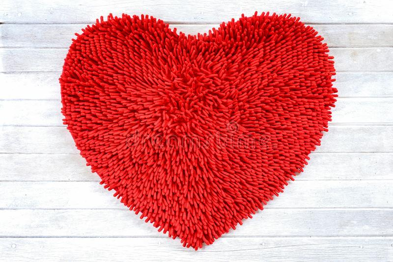 Red heart shape cleaning feet doormat or carpet texture. royalty free stock photography