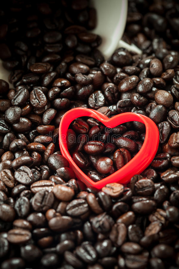 Red Heart shape coffee beans background stock photo