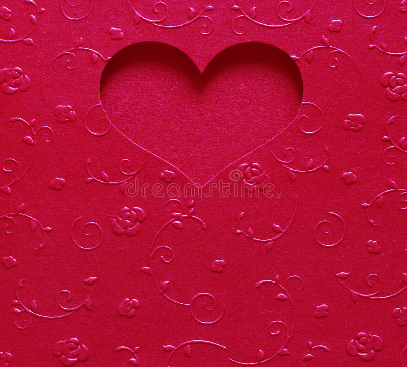 Red heart shape metallic color, card valentine on texture flower. Design royalty free stock images