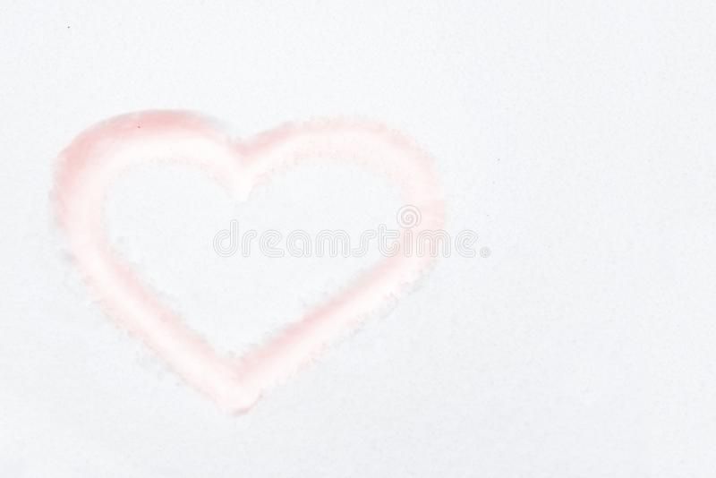 Red heart shape. Drawing on white snow as love valentine background stock image