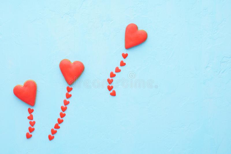 Red heart shaped balloons made of cookies and candy fly out. stock photos