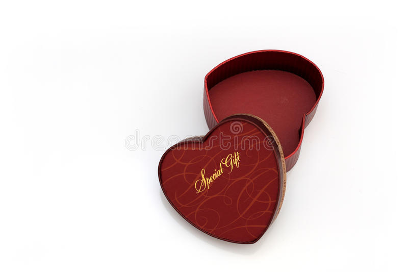 Red heart-shaped gift box royalty free stock image