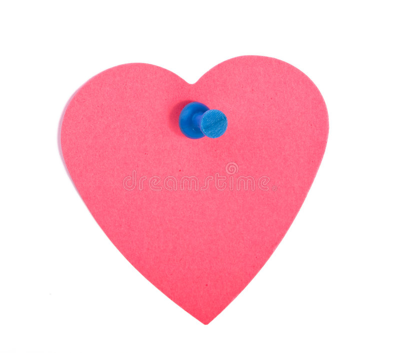 Red heart shaped note paper with blue pin stock photography