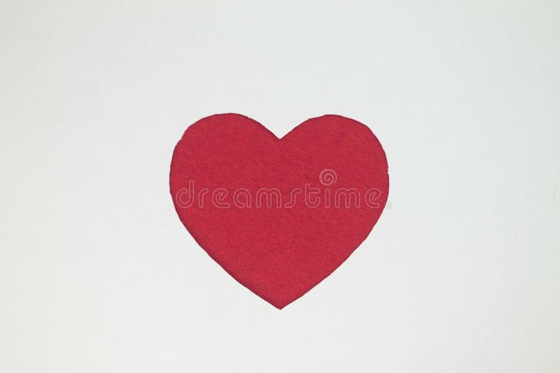 Red heart shaped slot in withe paper. royalty free stock image