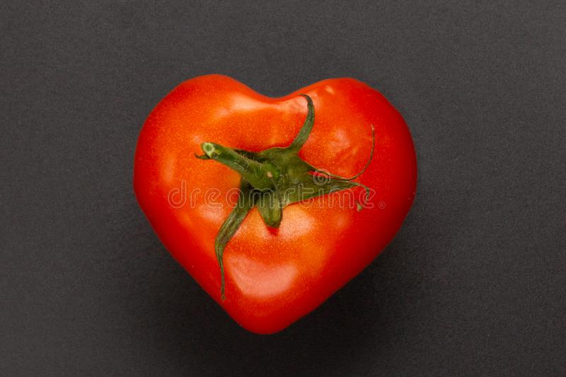 Red heart shaped tomato royalty free stock photo