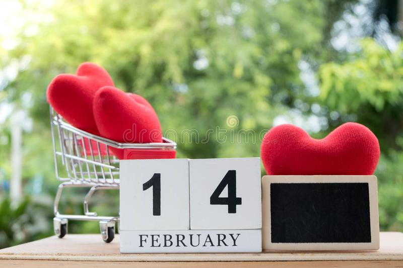 Red heart in a shopping cart on February 14.Valentine day stock image
