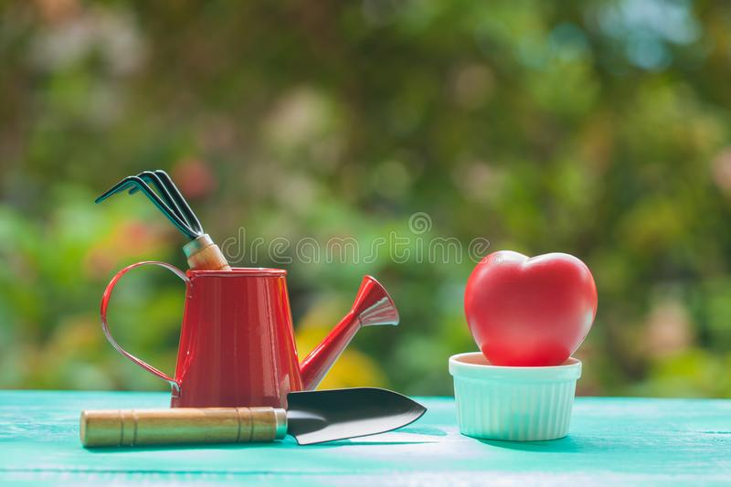 Red heart sign with garden work tool. Concept Love grow stock photo
