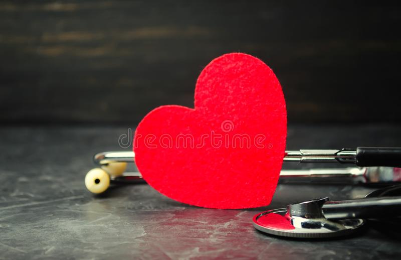 Red heart and stethoscope. The concept of medicine and health insurance, family, life. Ambulance. Cardiology Healthcare. royalty free stock image