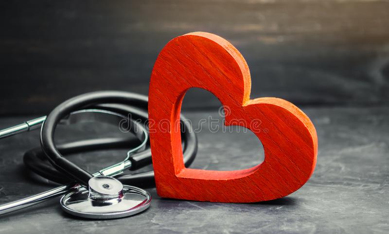 Red heart and stethoscope. The concept of medicine and health insurance, family, life. Ambulance. Cardiology Healthcare. Red heart and stethoscope. The concept royalty free stock photography