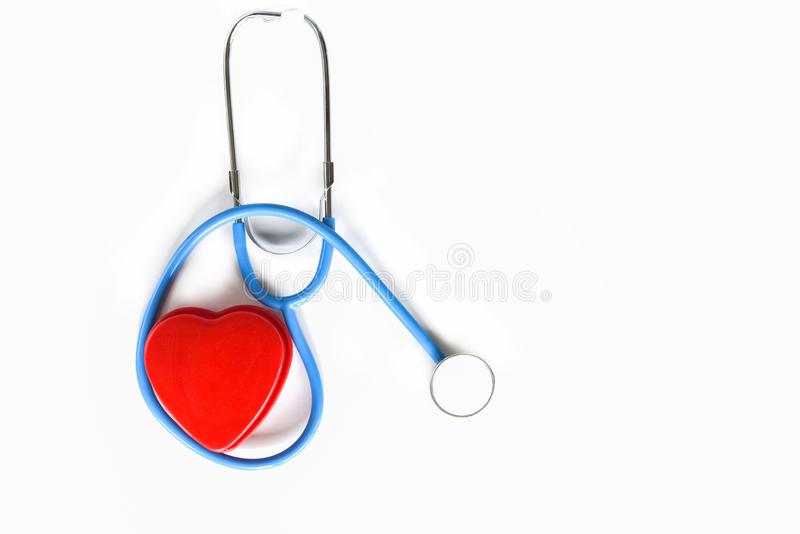 Red heart on stethoscope on white background , Copy space top view - Check the heart medical for doctor is the patient pulse stock photography