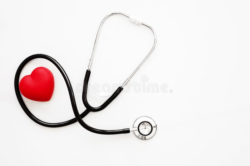 Red heart and a stethoscope on white background stock images