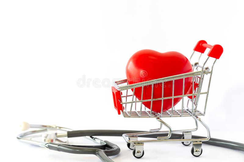 Red heart in a supermarket trolley and stethoscope. The concept of medicine and health insurance. royalty free stock images