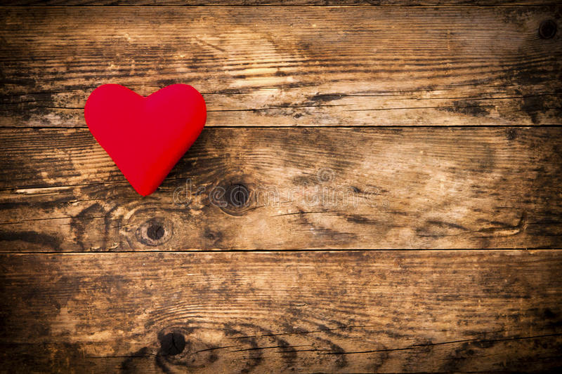 Red heart symbol on a rustic wooden planks. stock photography