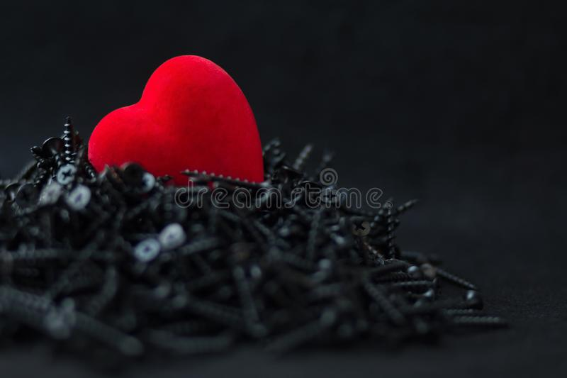 Red Heart Velvet on black prickly background royalty free stock photography