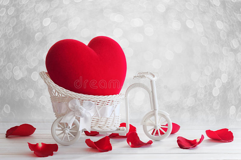 Red Heart in vintage bicycle basket stock image