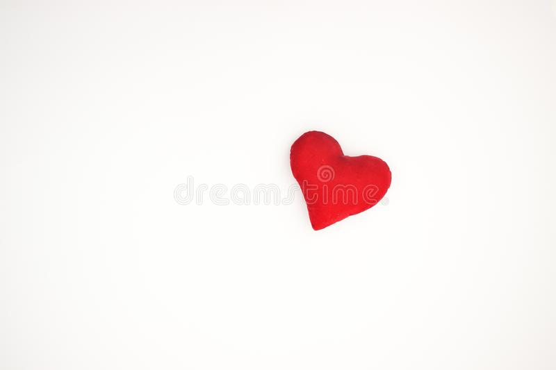 Red heart on the white background stock images