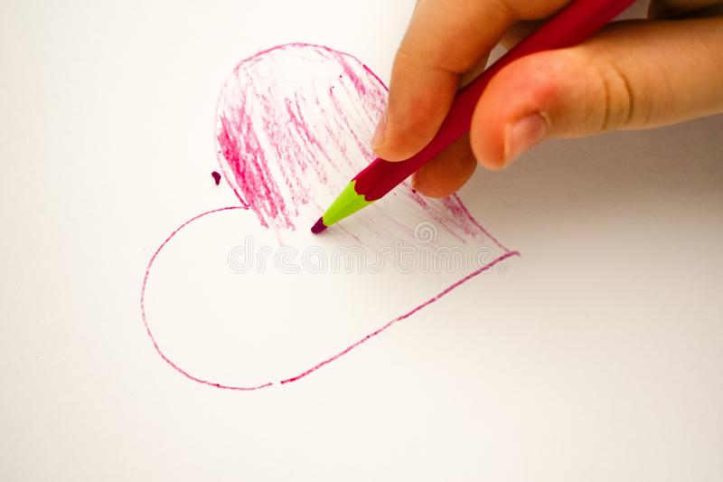 Child drawing heart on white background baby fingers. Red heart on white background child drawing pink pencil isolated love hand gift tenderness gentleness royalty free stock images