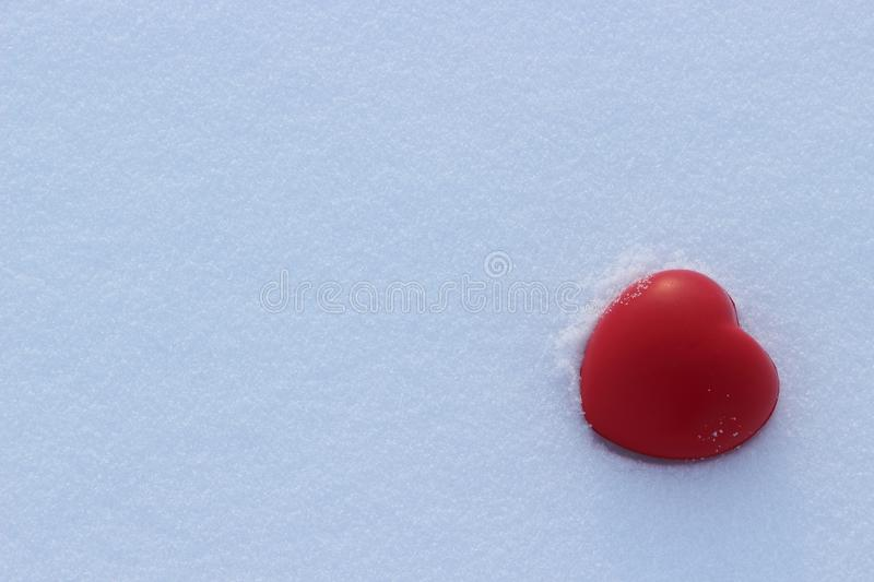 Red heart shape love on snow royalty free stock photo