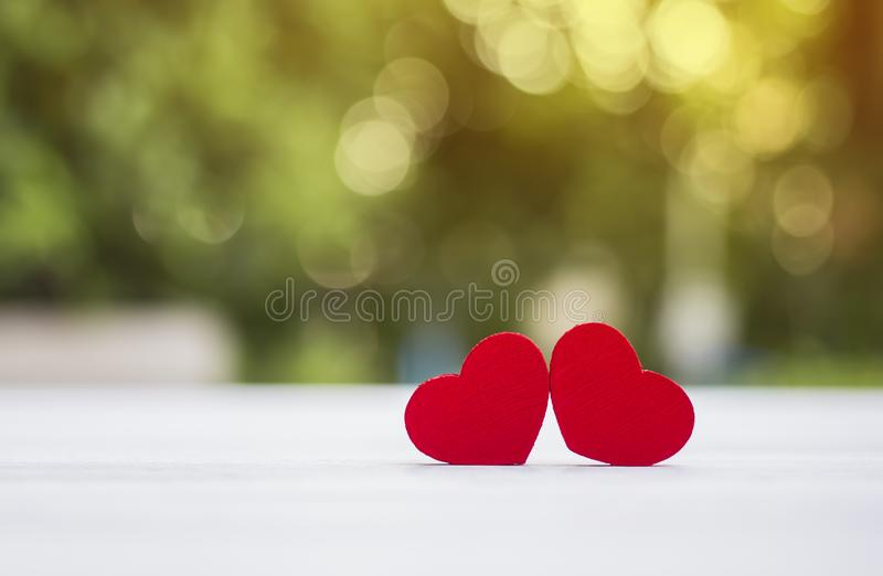 Red heart on white wood with bokeh background royalty free stock images