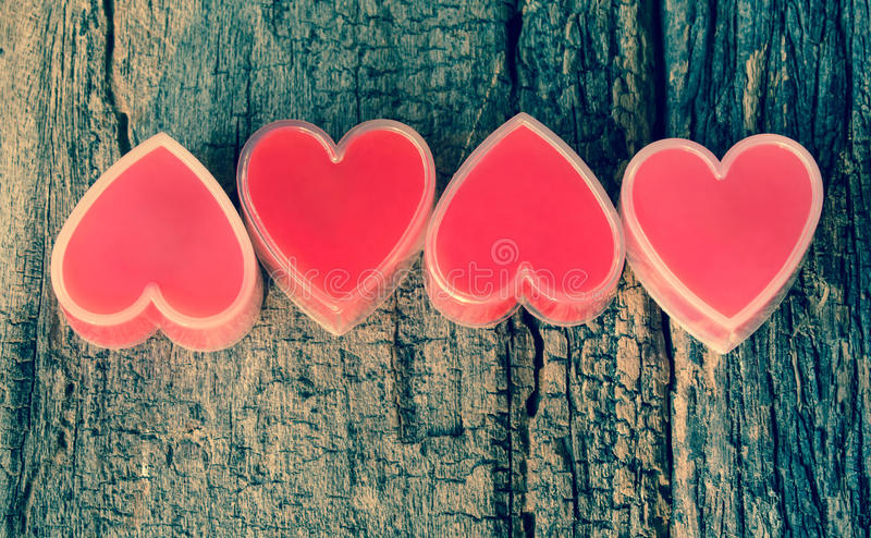Red heart on wood. royalty free stock image