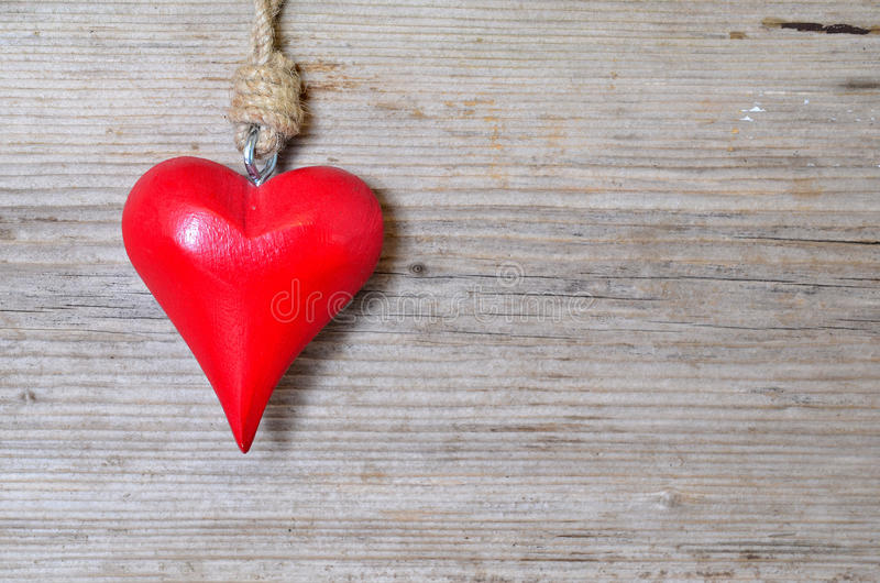 Red heart on wood. A red heart on an old wood background royalty free stock images