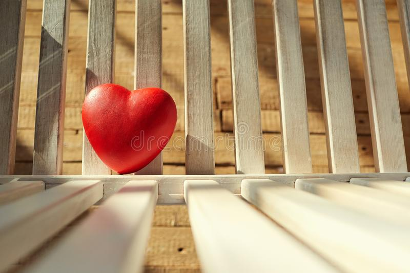 Red heart on a wooden background. stock photo
