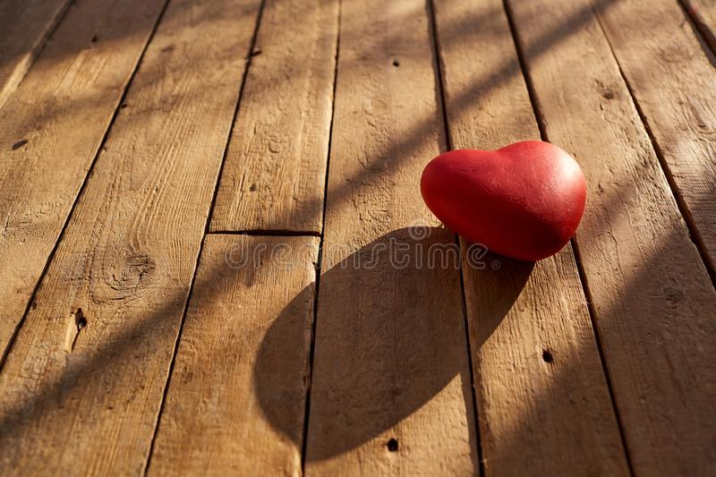 Red heart on a wooden background. royalty free stock image