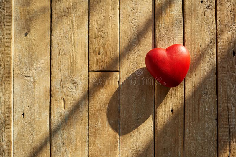 Red heart on a wooden background. royalty free stock photography
