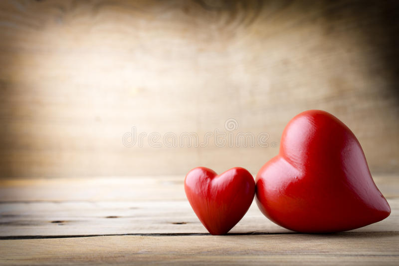 Red heart. Heart on a wooden board. Valentine's Day greeting card stock photos