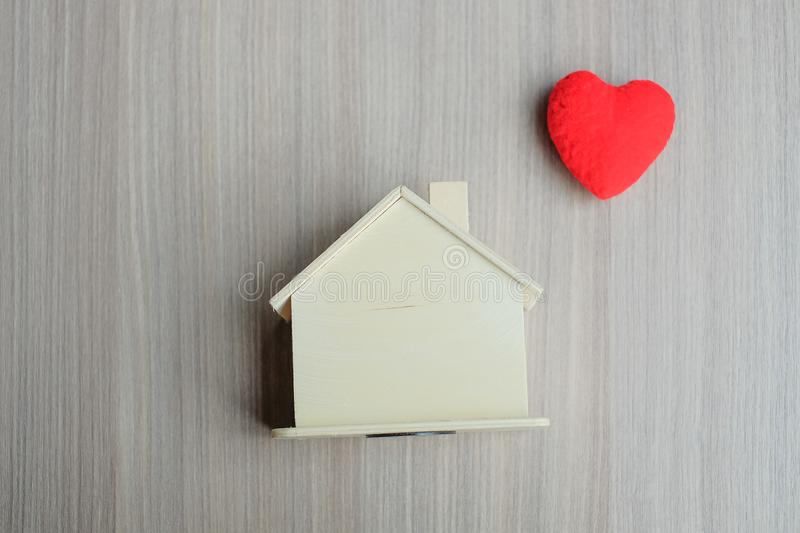 Red heart and wooden House model stock image