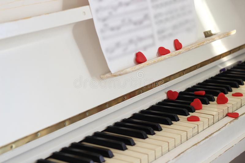 Red hearts adorn piano keys. Valentine`s Day . Red hearts adorn piano keys Valentine`s Day royalty free stock photography