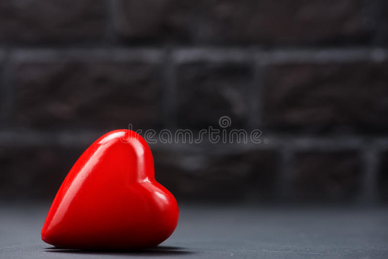 Red hearts. On the black table stock image