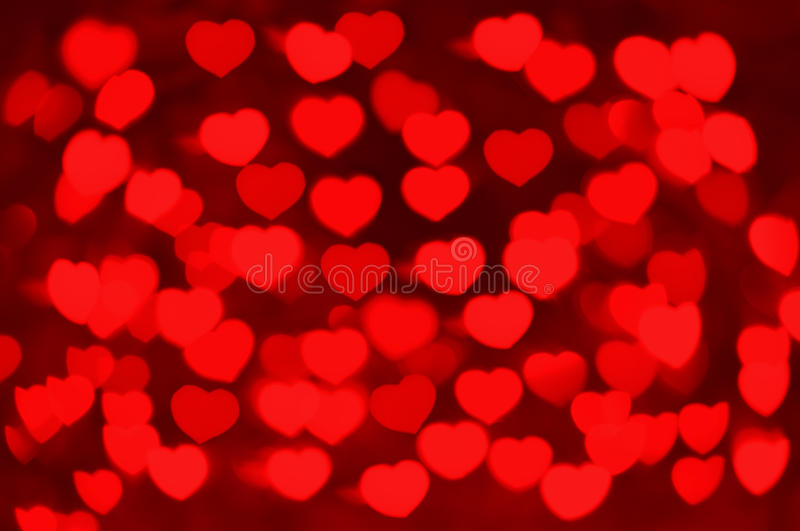 Red hearts bokeh as background. For Valentine`s day royalty free stock photo