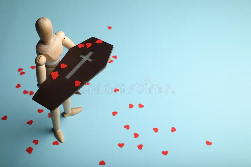 Red hearts on coffin, funeral. Loss of close and pain stock photo