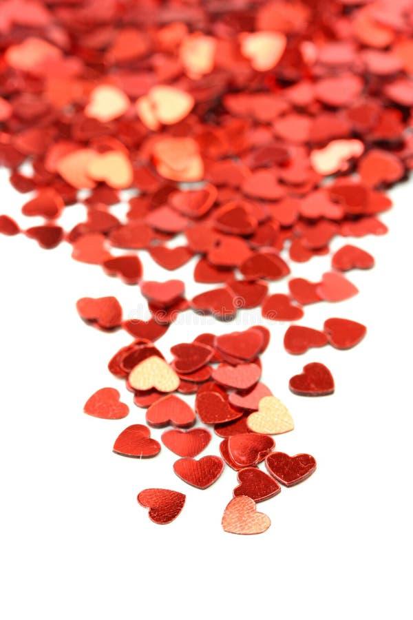 Red hearts confetti royalty free stock photo