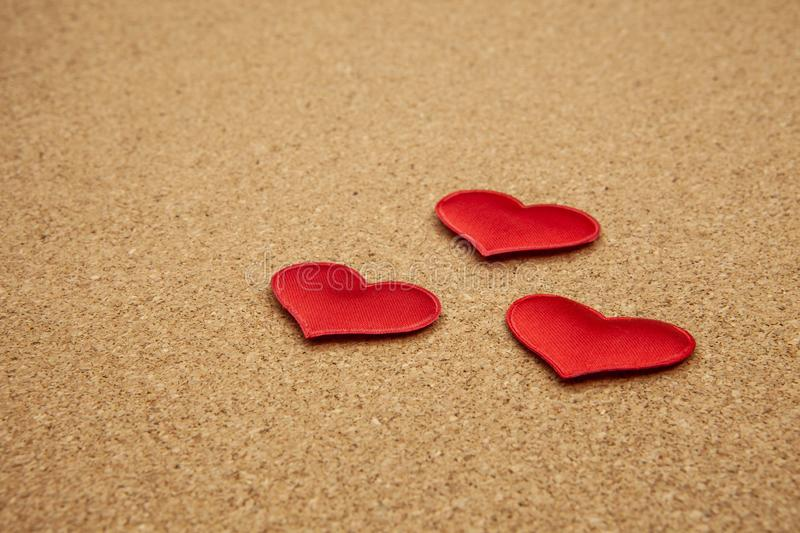 Red hearts on corkboard, strong love concept stock image