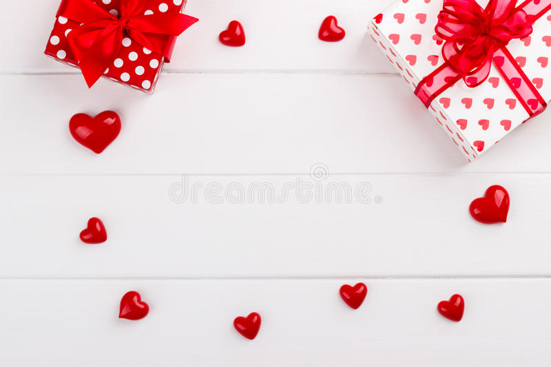 Red hearts and gift boxes stock photos
