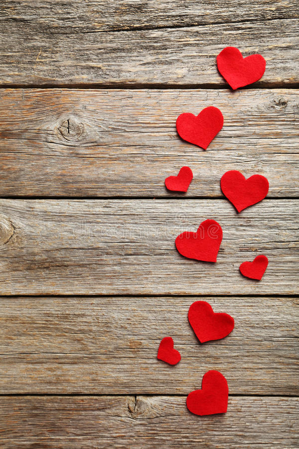 Red hearts. On a grey wooden table royalty free stock photo