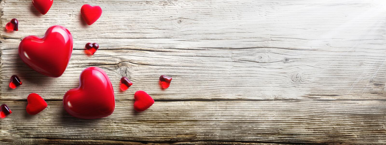 Red Hearts In love. On Vintage Wooden Plank royalty free stock images
