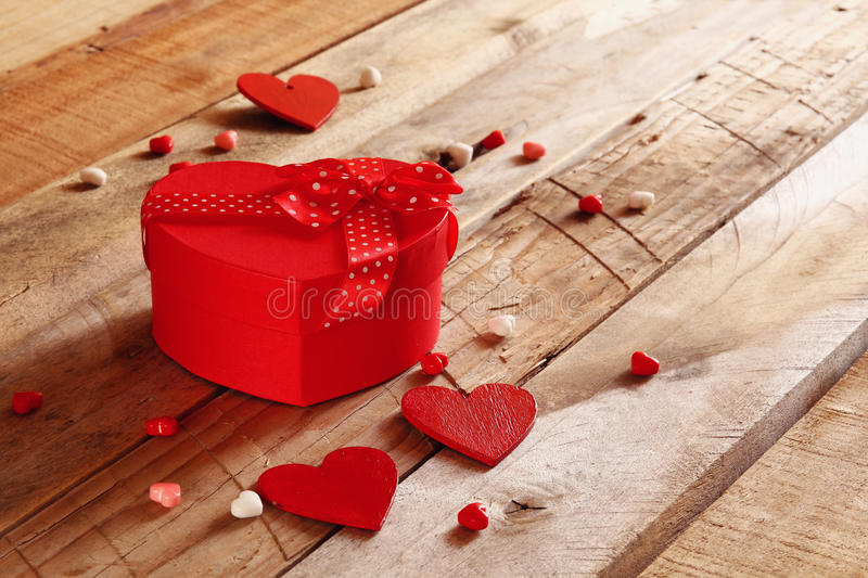 Download Red Hearts And Present Box On Wooden Table Stock Photo - Image of design, giving: 83700278