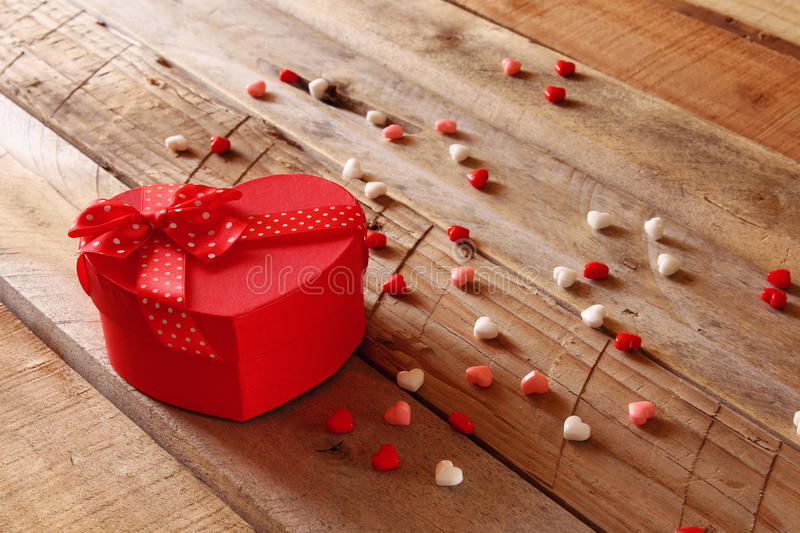 Download Red Hearts And Present Box On Wooden Table Stock Image - Image: 83700605