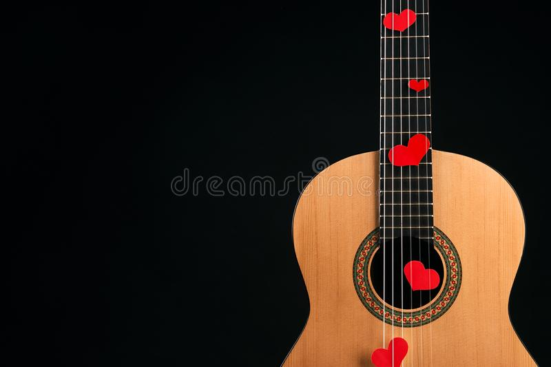 Red hearts on the strings of a guitar stock images