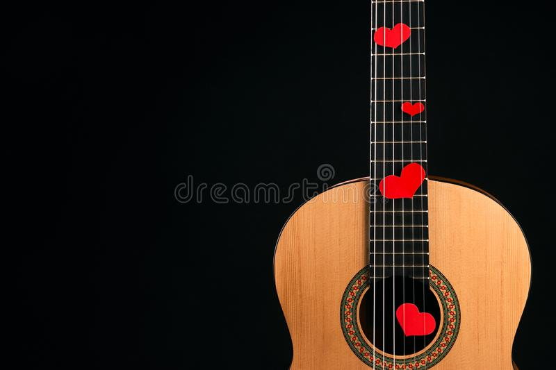 Red hearts on the strings of a guitar royalty free stock images