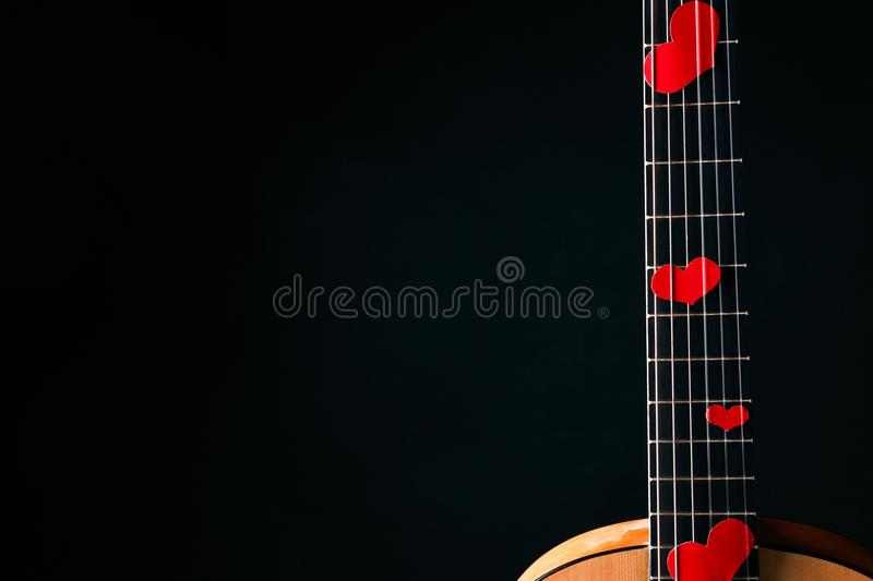 Red hearts on the strings of a guitar royalty free stock photography