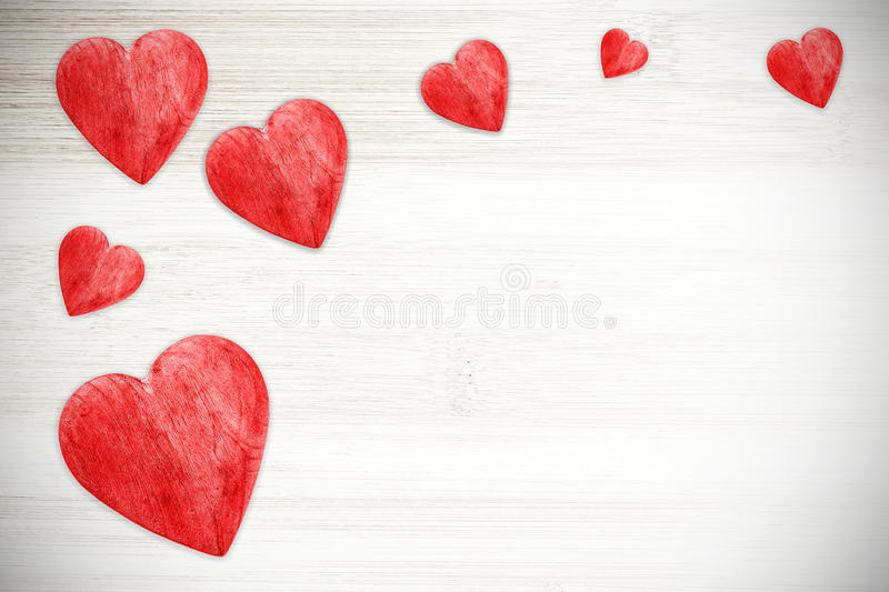 Red hearts on white timbered background, space for text. royalty free stock photo